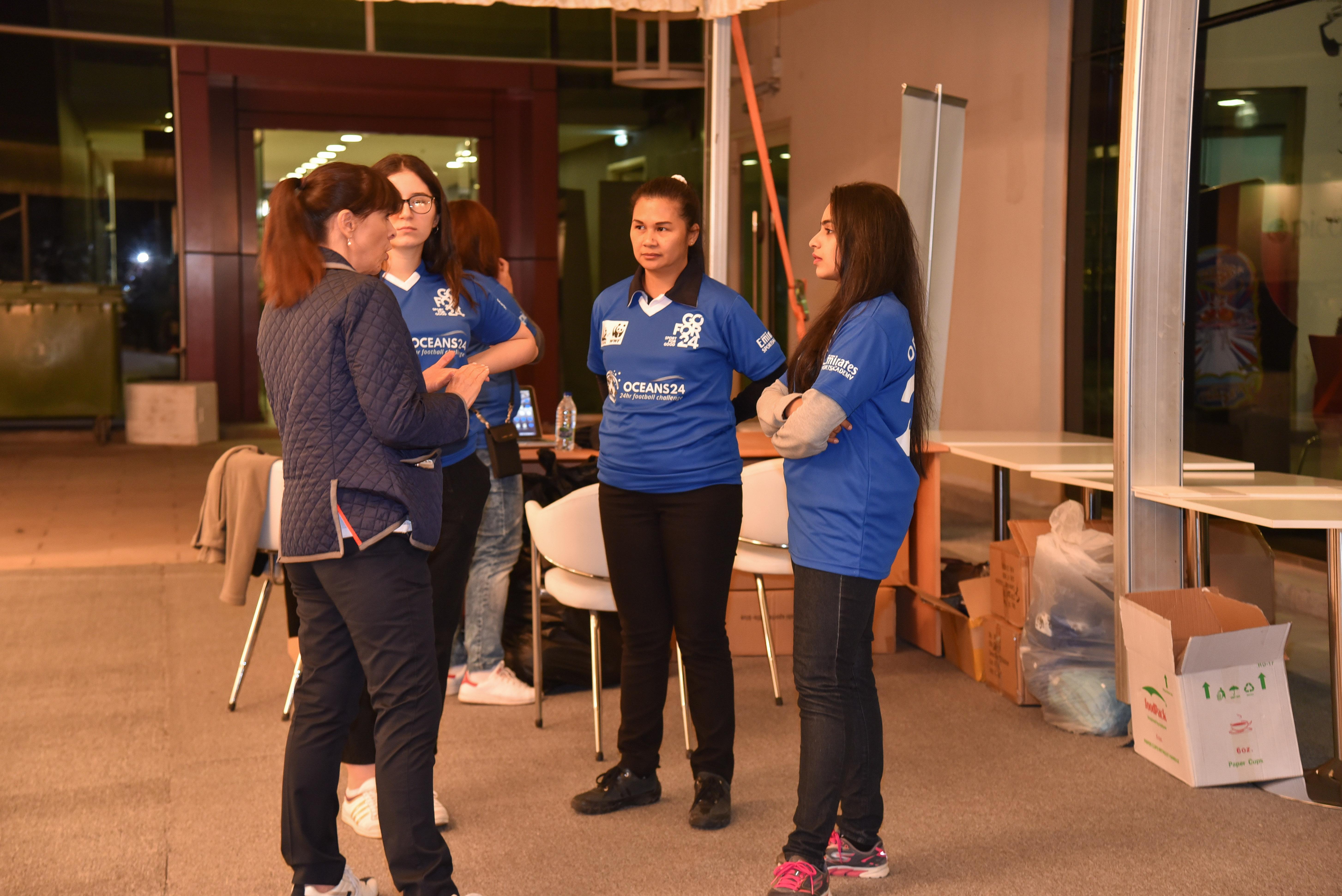 Volunteers getting instructions from EWS-WWF representative